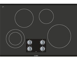 Bosch 30 inch smooth top 800 series in black with stainless steel strips NET8068SUC